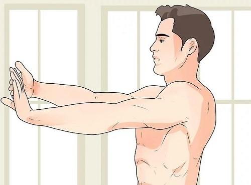 جلوی مچ دست خود را کشش دهید